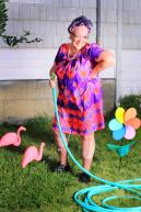 silly-granny-gardener-happy-senior-gray-haired-lady-wearing-cat-eye-glasses-muumuu-dress-pearls-curlers-her-hair-doing-33956682